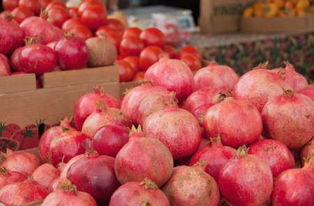 pomegranates and tomatoes at the farmers market Stock Photo
