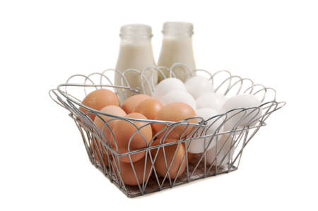a basket of eggs with bottles of soymilk Stock Photo
