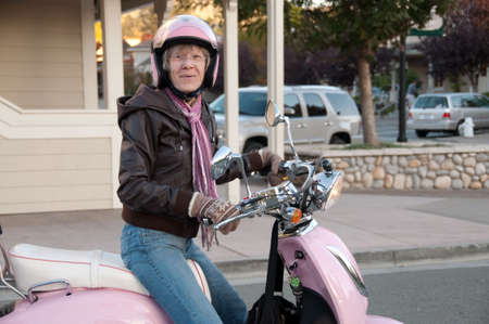 sixty: sixty year old woman stops in the street on her scooter