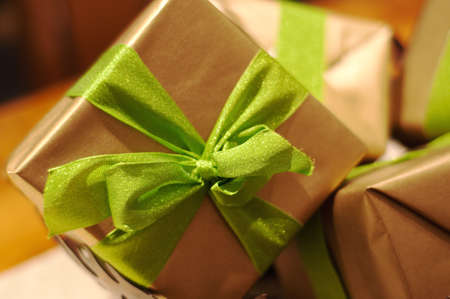 christmas gifts wrapped in gold and green photo