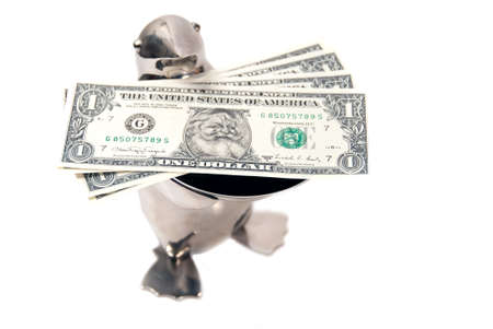 legal tender: penguin bearing gifts of limited edition legal tender us dollar notes with santas picture Stock Photo