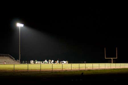 stadium light shines brightly on the field Stock Photo