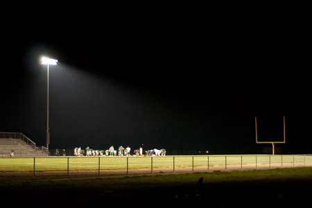 stadium light shines brightly on the field Stock Photo