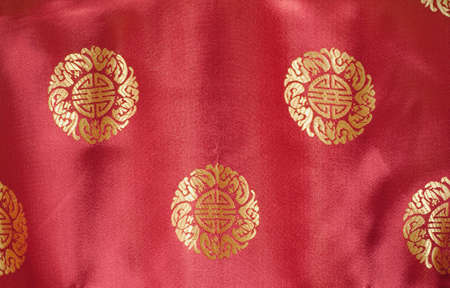 embroidered: chinese motif with the word longevity embroidered in gold