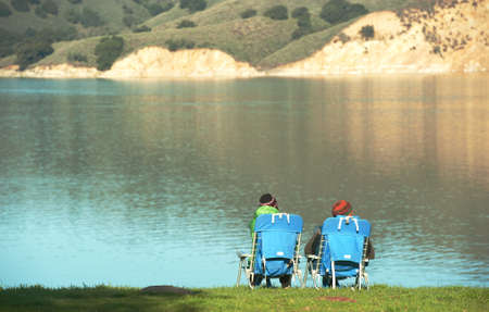 two campers look out onto cachuma lake in santa barbara county