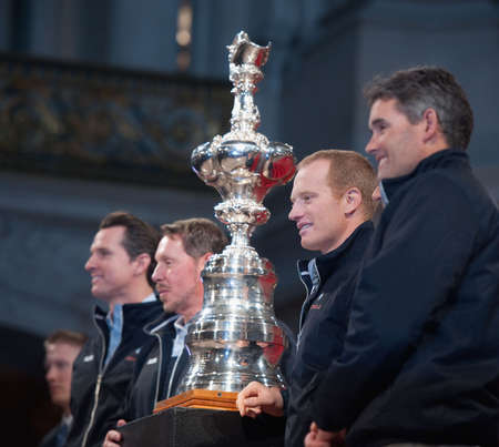 SAN FRANCISCO - FEB 2010: (L to R) SFO Mayor Gavin Newsom, CEO Larry Ellison, James Spithill, Russell Coutts celebrate the return of the America's Cup at City Hall