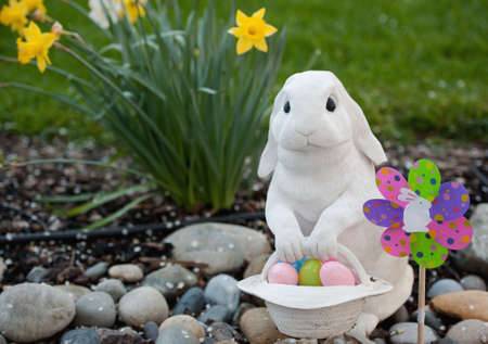 white rabbit with a basket of easter eggs photo