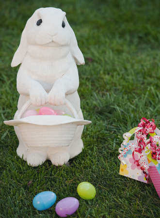 white rabbit on lawn with easter eggs Archivio Fotografico