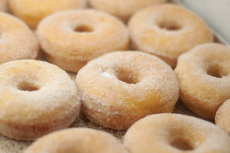 a tray of sugar dusted donuts