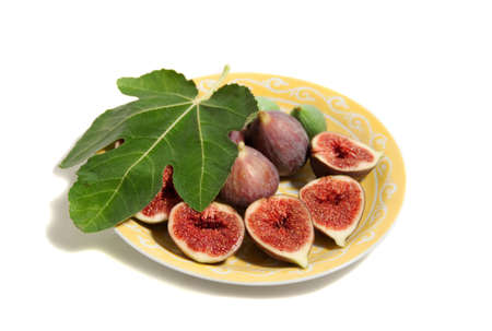 a plate of figs isolated on white