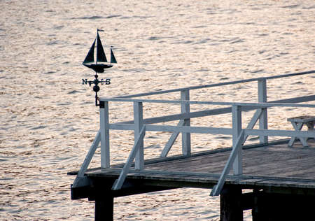 a sailboat weather vane on a boat dock in the bay of san francisco