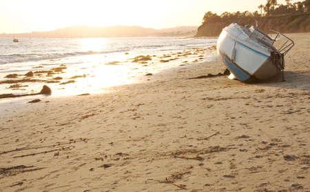 abandoned boat on butterfly beach Banco de Imagens