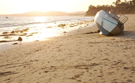 abandoned boat on butterfly beach Archivio Fotografico