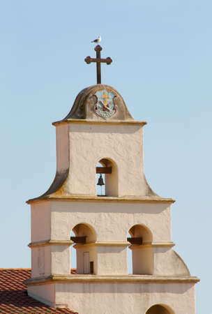 traditional mission bells with cross and seagull in santa barbara Banco de Imagens