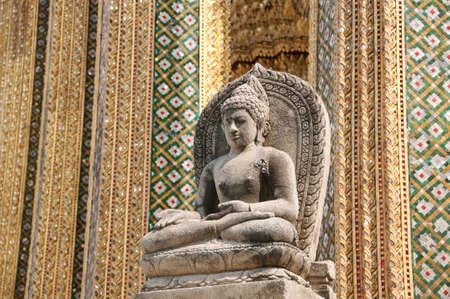 a buddhist statue at the grand palace in bangkok photo