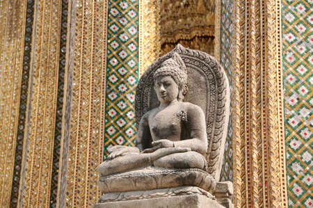 a buddhist statue at the grand palace in bangkok
