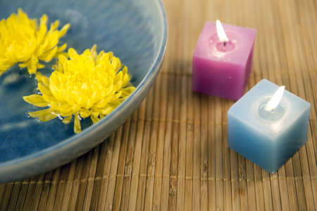 yellow chrysanthemums and aromatherapy candles  Archivio Fotografico
