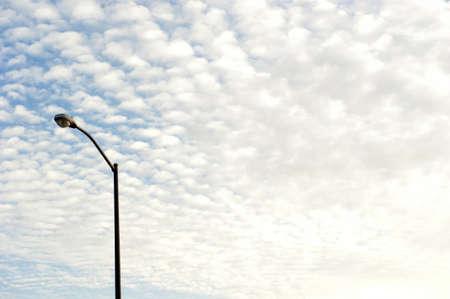 street lamp against cloudscape