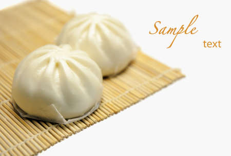 Chinese baoze on bamboo mat with copy space Stock Photo
