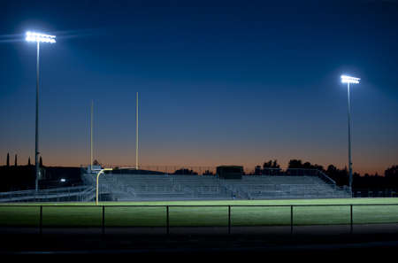 two stadium lights sparkle in the night