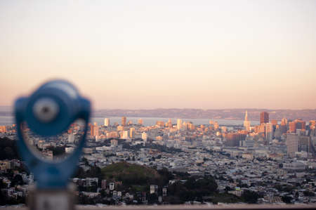 telescopes: cityscape of san francisco with the city of oakland across the bay