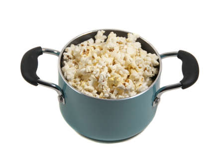freshly popped corn in turquoise pot