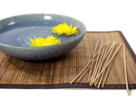 chrysanthumum flowers in a blue bowl Stock Photo