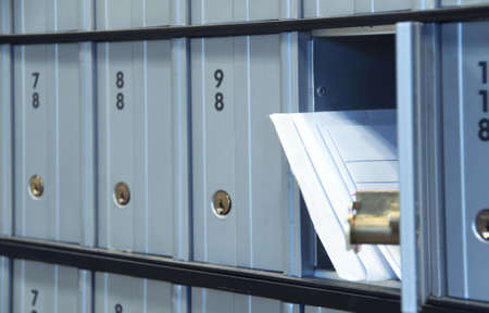 post box: mail waiting in the u.s. greyblue post office box Stock Photo