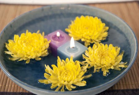 aromatherapy candles and mums in water