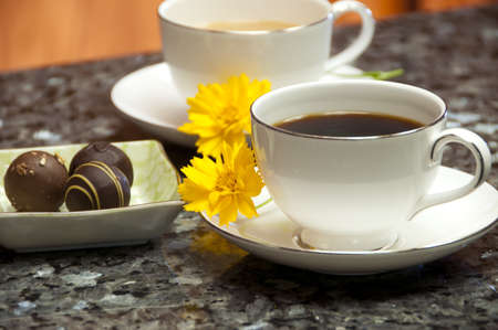 white and black coffee with chocolate truffles