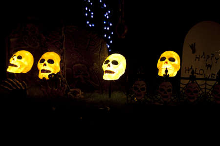 lighted skullcaps in a graveyard