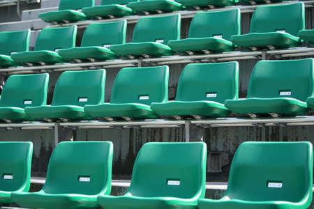 Empty stadium seating stand with no spectators