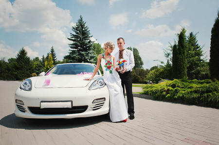 supercar: Wedding beautiful couple in traditional dress near exotic supercar