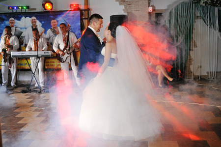 wedding bride: first wedding dance with light and smoke