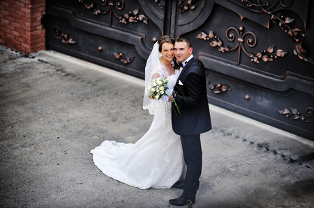 wrought: wedding couple near wrought iron gates