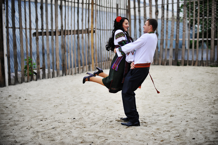 horse love horse kiss animal love: Young couple on national dress dancing