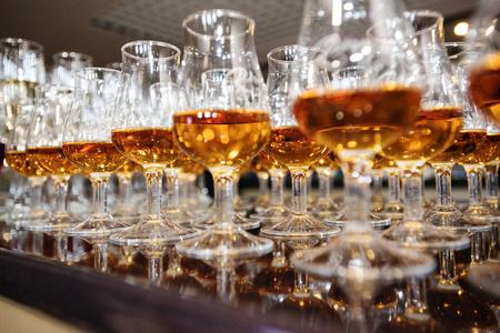 amaretto: wine, champagne, cognac glasses on wedding reception