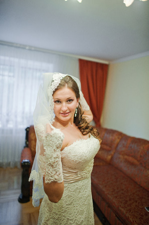 beauties: Happy bride on veil at the wedding day