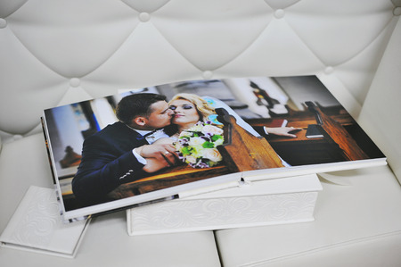 photo paper: white leather wedding photo book album Stock Photo