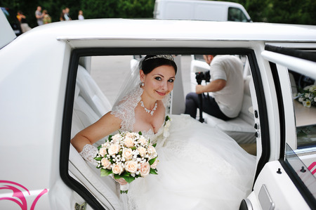 limousine: happy bride on wedding limousine