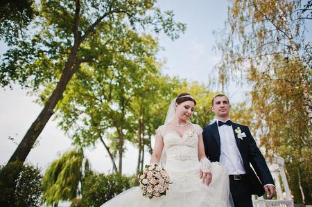 wedding couple near marriage arch photo