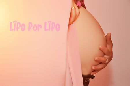 baby bump: Pregnant woman holding hand on her baby bump