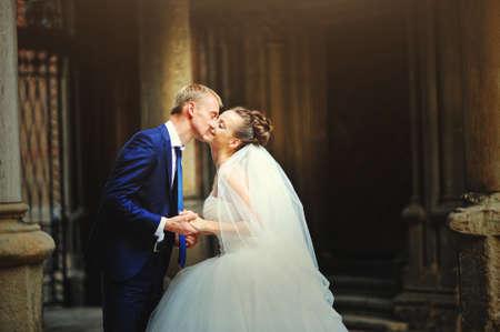 tenderly: groom tenderly kissing his wife