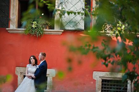 couple background: wedding couple background orange wall of house with original windows Stock Photo