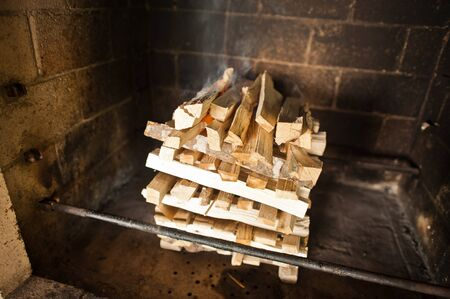 kebob: wood with fire on stone oven