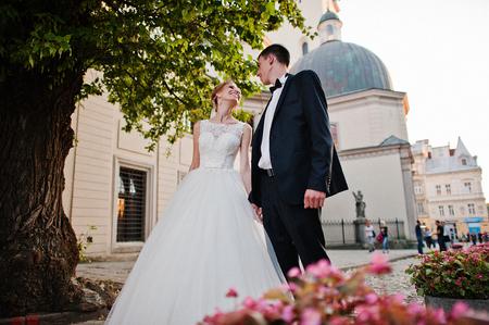 lviv: wedding couple in love on streets of evening Lviv, Ukraine