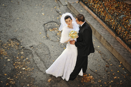 wedding couple in autumn leaves, view from high