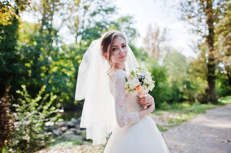 voile: portrait of bride with bouquet Stock Photo