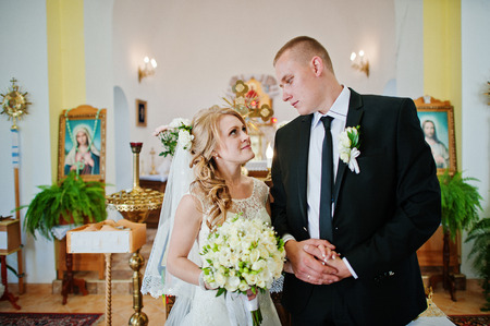 looked: wedding couple stay at church and looked each other Stock Photo