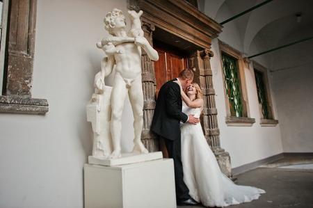 naked statue: wedding couple background statue of naked man
